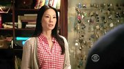 Although gingham shirts are typically saved for summer months, Lucy Liu made the look work on 'Elementary' with the addition of a cozy tan cardi.