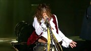 Ahoy, matey! Steven Tyler hit the stage with his band Aerosmith in a white pirate style top and burgundy velvet vest.